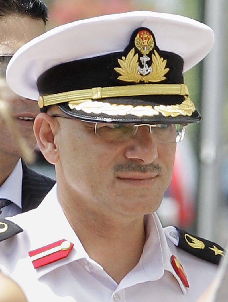 FILE - In this July 19, 2011 file photo, United Arab Emirates Col. Arif Mohamed Saeed Mohamed Al-Ali enters Federal Court in Providence, R.I.  Al-Ali was ordered Wednesday, Dec. 26, 2012, to pay $1.2 million to former domestic worker Elizabeth Ballesteros, who accused him of imprisoning her and forcing her to work long hours for little pay. (AP Photo/Stephan Savoia, File)