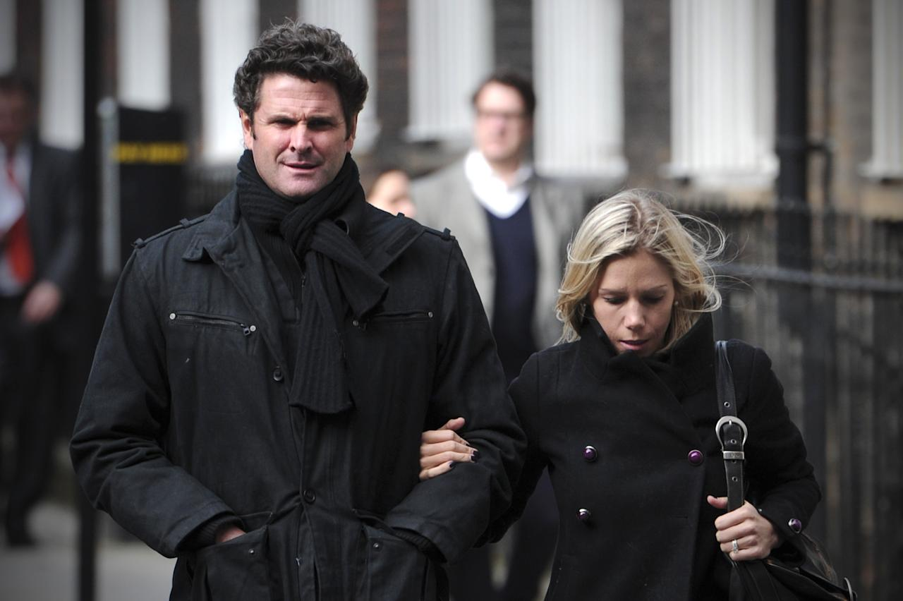"Former New Zealand cricketer Chris Cairns (L) and wife Melanie Croser (R) return to the High Court in central London on March 5, 2012, after a lunch break in a hearing in a libel case Cairns has brought against ex-chairman of India's cricket IPL Lalit Modi. Former New Zealand cricket captain Cairns asked the High Court for substantial libel damages over an accusation of match-fixing which had turned his achievements to ""dust"". Cairns, 41, who notched up the rare double of 200 wickets and 3,000 runs in his 62 Tests, is suing Lalit Modi, ex-chairman of Twenty20 franchise the Indian Premier League (IPL) over an ""unequivocal allegation"" on Twitter.  AFP PHOTO / CARL COURT (Photo credit should read CARL COURT/AFP/Getty Images)"