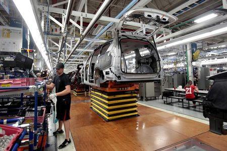 FILE PHOTO - An FCA assembly worker works on the production line of the 2017 Chrysler Pacifica minivan at the FCA Windsor Assembly plant in Windsor