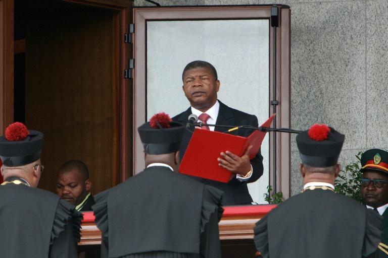 Newly elected Angolan President Joao Lourenco reads the oath of office during his swearing in ceremony in Luanda