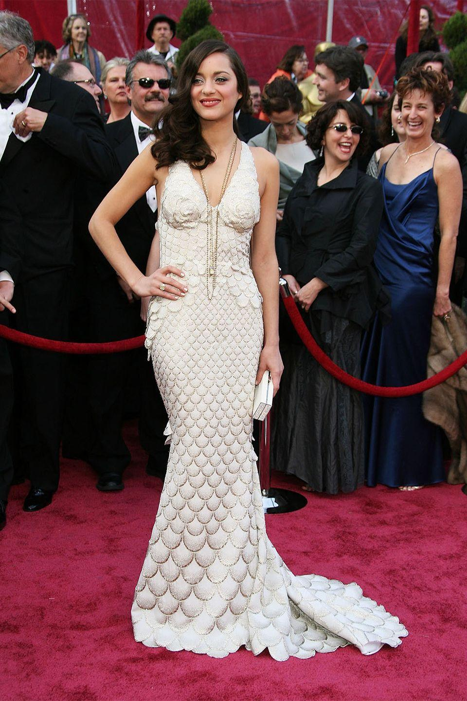<p>In a sea of tulle and crystal embellished gowns, Marion Cotillard stood out on the red carpet in a Jean Paul Gaultier dress that looked as though it was literally made of fish scales. </p>