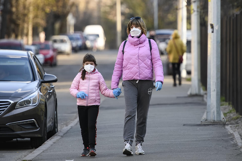 Woman with child in protective masks as a preventive measure against the coronavirus COVID - 19 on street in Kyiv, Ukraine on April 04, 2020 (Photo by Maxym Marusenko/NurPhoto via Getty Images)