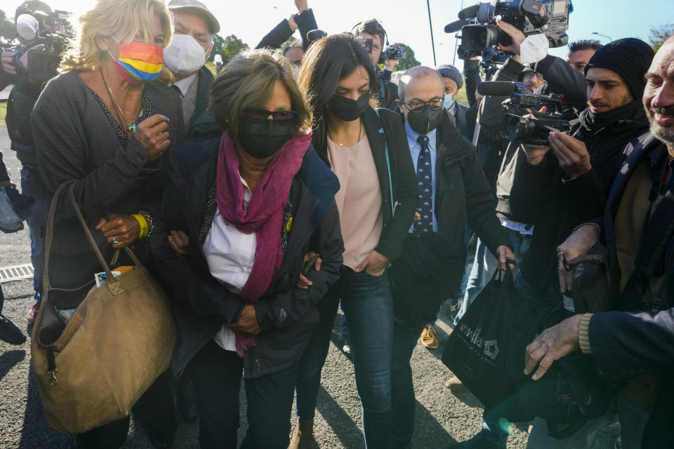 The family of slain Italian doctoral student Giulio Regeni, father Claudio Regeni, second from left, his wife Paola, third from left, and Giulio's sister Irene, fourth from left, arrive with their lawyer Alessandra Ballerini, left, at the Rebibbia prison in Rome, Thursday, Oct. 14, 2021, to attend the first hearing of the trial for the death of Italian doctoral student Giulio Regeni, who disappeared for several days in January 2016 before his body was found on a desert highway north of the Egyptian capital. Italian prosecutors have formally put four high-ranking members of Egypt's security forces under investigation for their alleged roles in the slaying. (AP Photo/Andrew Medichini)