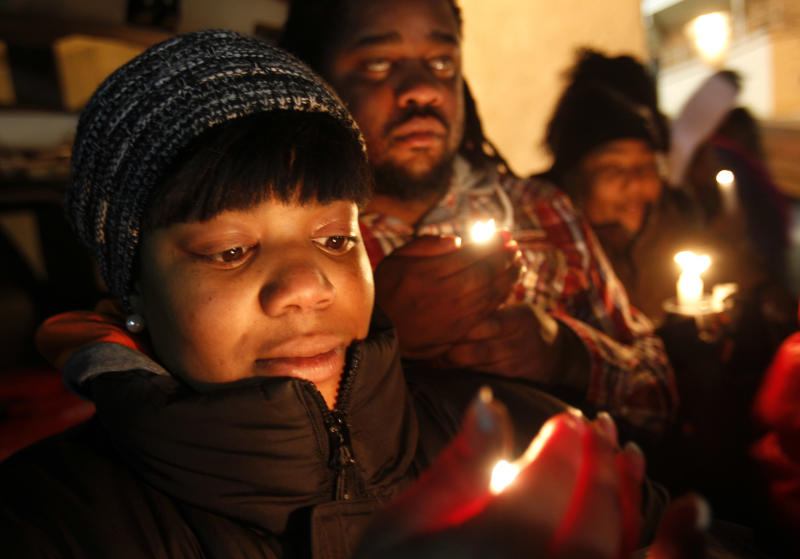 Tamika Solomon, of Newark, N.J., takes part in a candlelight vigil as they wait for Whitney Houston's body to arrive at the Whigham Funeral Home, in Newark, N.J., Monday, Feb. 13, 2012. The 48-year-old pop star was found dead in the bathtub in her hotel room at the Beverly Hilton Hotel on Saturday, hours before she was supposed to appear at a pre-Grammy gala. (AP Photo/Rich Schultz)