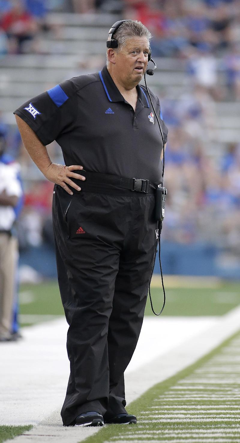 Kansas head coach Charlie Weis watches during the second half of an NCAA college football game against Central Michigan on Saturday, Sept. 20, 2014, in Lawrence, Kan. Kansas won 24-10