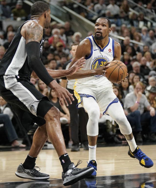 Golden State Warriors' Kevin Durant (35) drives against San Antonio Spurs' LaMarcus Aldridge during the first half of Game 4 of a first-round NBA basketball playoff series in San Antonio, Sunday, April 22, 2018, in San Antonio. (AP Photo/Darren Abate)