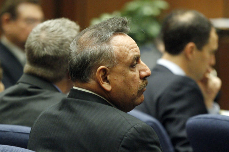 Former Bell, Calif. mayor Oscar Hernandez listens to opening statements in a massive city corruption trial in a downtown Los Angeles courtroom Thursday, Jan. 24, 2013. The former mayor and vice mayor and four former city council members of the Los Angeles suburb of Bell are charged with misappropriation of public funds in a plot to line their own pockets at the expense of citizens. Those on trial are Hernandez, former vice mayor Teresa Jacobo, and former council members, George Mirabal, George Cole, Victor Bello and Luis Artiga. (AP Photo/Los Angeles Times, Irfan Khan, Pool)