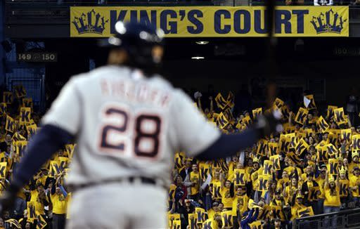 """Fans in the """"King's Court"""" cheering section for Seattle Mariners starting pitcher Felix Hernandez hold signs with K's for a strikeout after Detroit Tigers' Prince Fielder (28) was called out on strikes in the fourth inning of a baseball game, Wednesday, April 17, 2013, in Seattle. (AP Photo/Ted S. Warren)"""