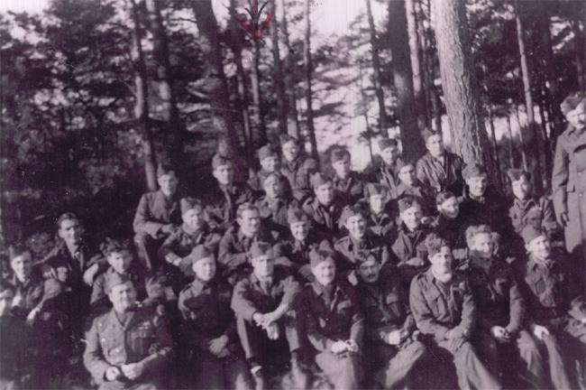 "<span>Group shot taken at Stalag Luft I in 1945. Merrill Weicker is 3rd from the left of the tree in the top row. Photo courtesy of <a target=""_blank"" href=""http://www.thememoryproject.com/stories/832:merrill-weicker/"">Historica-Dominion Institute</a>. </span>"