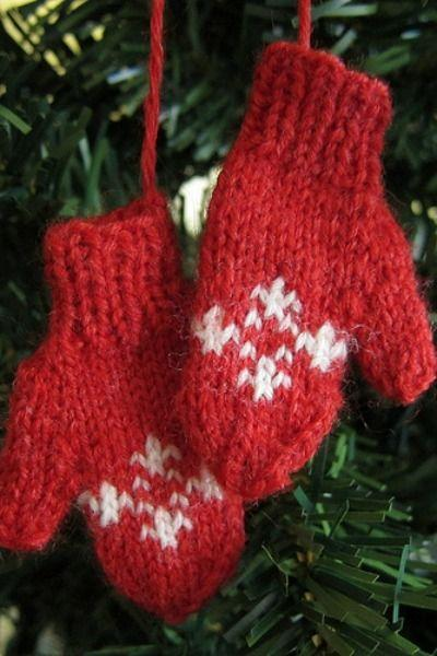 """<p>These adorable mini mittens are a perfect addition to a wintry Christmas tree. </p><p><strong>Get the tutorial at <a href=""""http://www.justcraftyenough.com/2012/07/advent-calendar-project-week-4/"""" rel=""""nofollow noopener"""" target=""""_blank"""" data-ylk=""""slk:Just Crafty Enough"""" class=""""link rapid-noclick-resp"""">Just Crafty Enough</a>.</strong> </p>"""