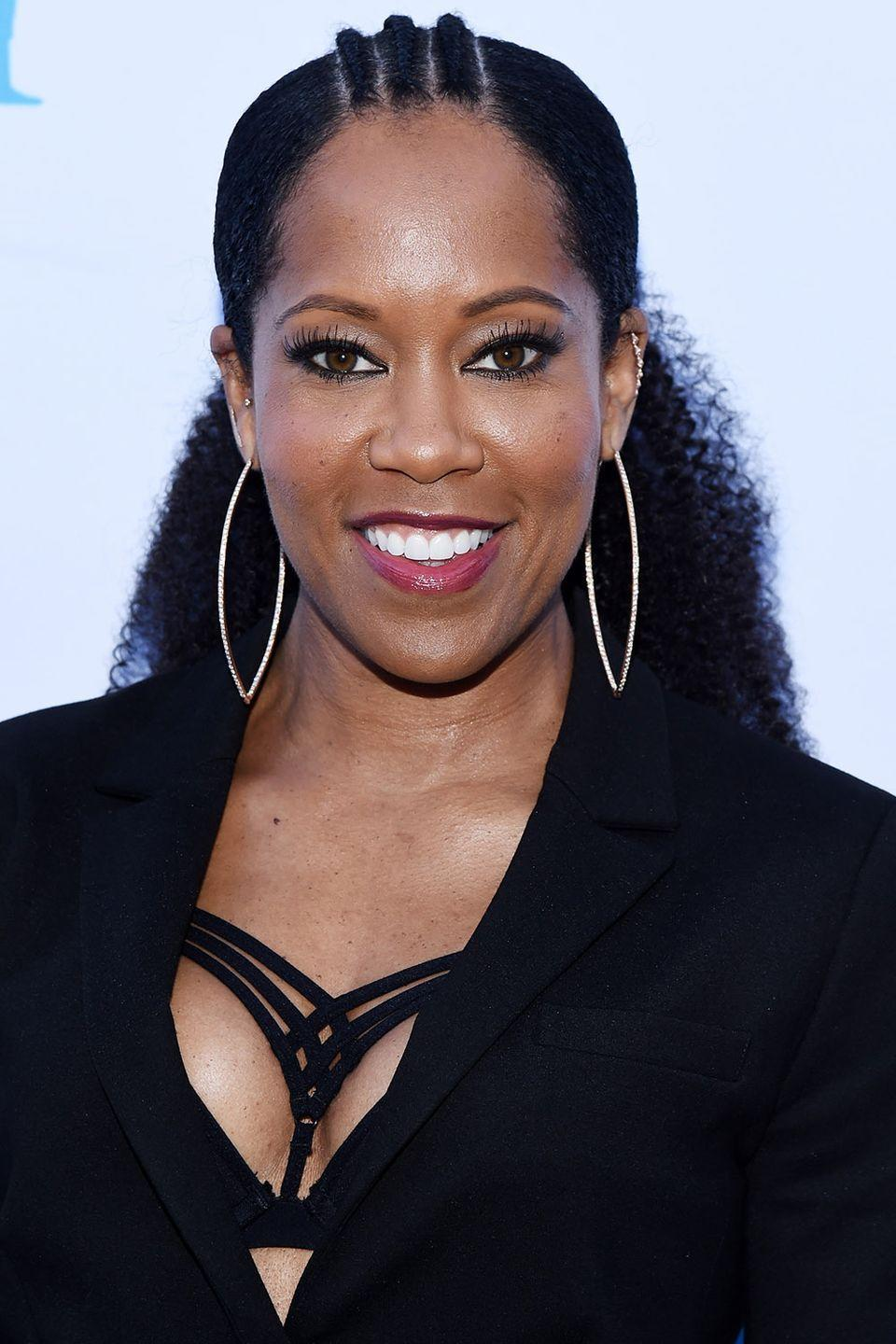 <p>Regina King adds just three cornrows to add some beautiful detail to her low, voluminous ponytail. </p>