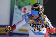 Switzerland's Lara Gut-Behrami gets to the finish area after completing the women's downhill, at the alpine ski World Championships in Cortina d'Ampezzo, Italy, Saturday, Feb. 13, 2021. (AP Photo/Giovanni Auletta)
