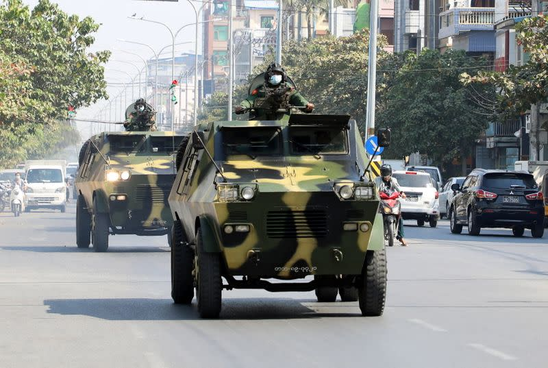Myanmar Army armored vehicles drive in a street