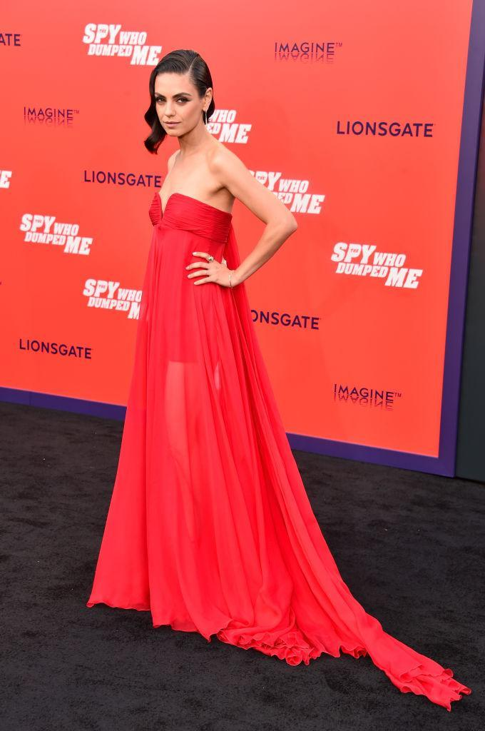 <p>On 25 July, Mila Kunis graced the red carpet in a cold-shoulder gown by Valentino. <em>[Photo: Getty]</em> </p>
