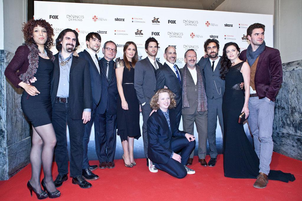 "The cast and producers of ""Da Vinci's Demons"" attend the world premiere screening at the Cinema Teatro Odeon in Florence, Italy on April 2. Left to right: Singer Raya Yarbough, composer Bear McCreary, Blake Ritson, David Schofield, Laura Haddock, Tom Riley (Da Vinci), creator/producer David S. Goyer, Allan Corduner, Gregg Chillin, Lara Pulver, Tom Bateman and seated Eros Vlahos."