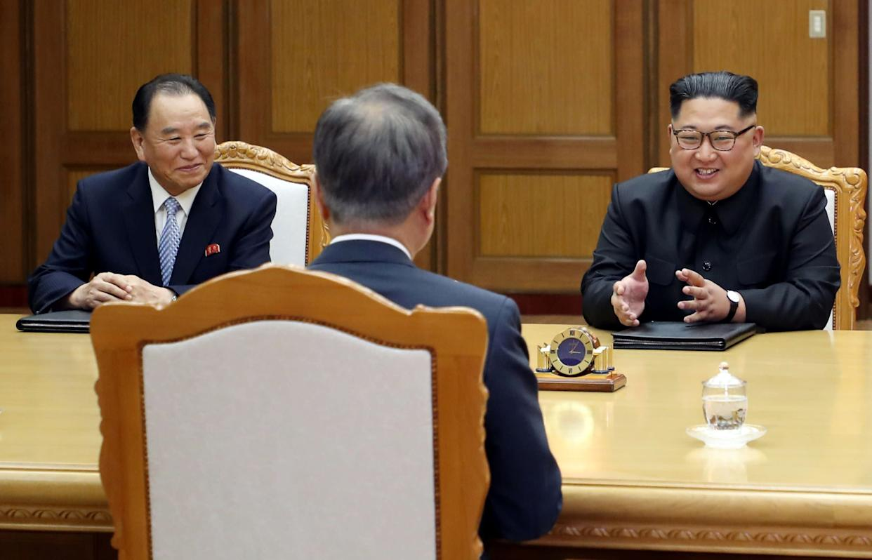 Kim Yong Chol (left) and Kim Jong Un speaking with South Korean President Moon Jae In at a meeting at the truce village of Panmunjom on May 26, 2018. (Photo: Reuters)