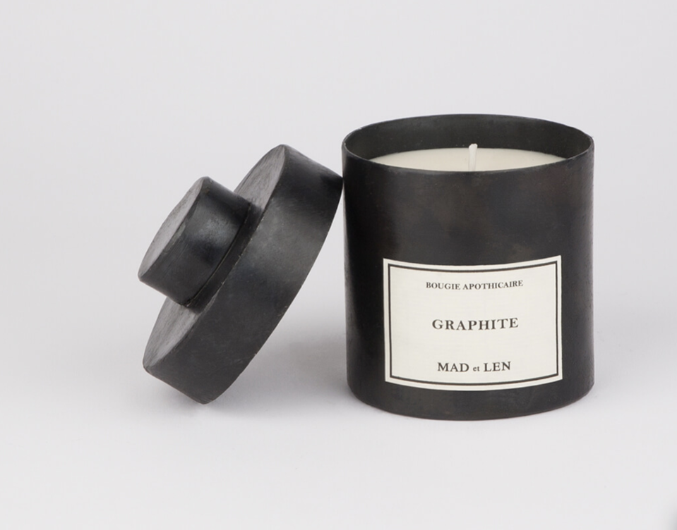 """<p><strong>Mad et Len</strong></p><p><strong>$85.00</strong></p><p><a href=""""https://madetlen.com/scented-candles/scented-candles-graphite/"""" rel=""""nofollow noopener"""" target=""""_blank"""" data-ylk=""""slk:BUY NOW"""" class=""""link rapid-noclick-resp"""">BUY NOW</a></p><p>""""I love MAD et LEN in Graphite. It's a soft, sexy scent that's easy to live with. The candles come in these beautiful steel containers that fit nicely with my interiors. An added plus during the pandemic is they are hand-made in Paris, which brings a much-needed boost of Parisian energy at the moment."""" <a href=""""http://www.chaddorseydesign.com/"""" rel=""""nofollow noopener"""" target=""""_blank"""" data-ylk=""""slk:Chad Dorsey"""" class=""""link rapid-noclick-resp"""">Chad Dorsey</a> </p>"""