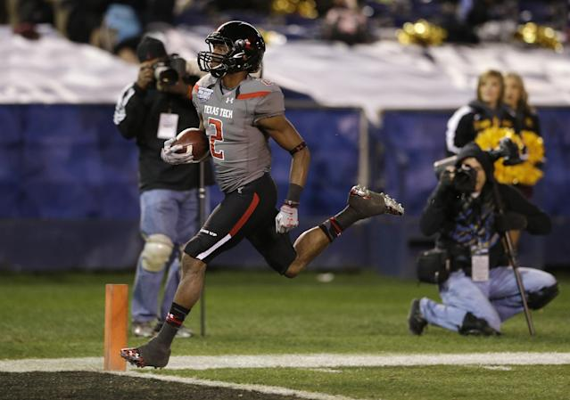 Texas Tech kick returner Reginald Davis returns a kickoff for 90 yards and a touchdown against Arizona State in the second half during the Holiday Bowl NCAA college football game Monday, Dec. 30, 2013, in San Diego. (AP Photo/Gregory Bull)