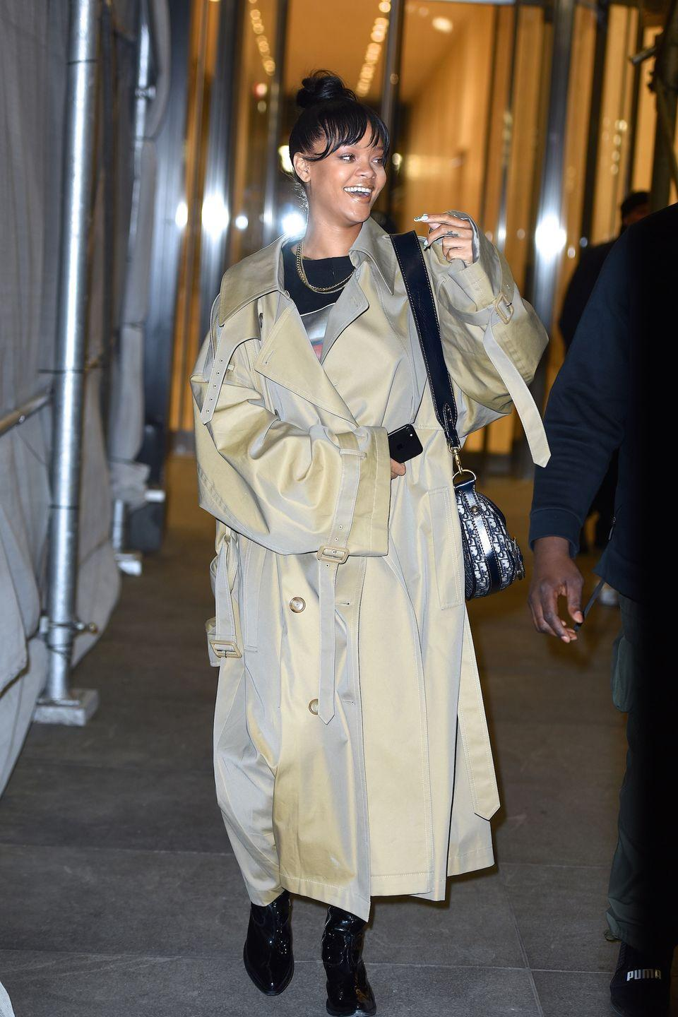 <p>In a two toned trench coat and black patent leather boots while out in New York. </p>