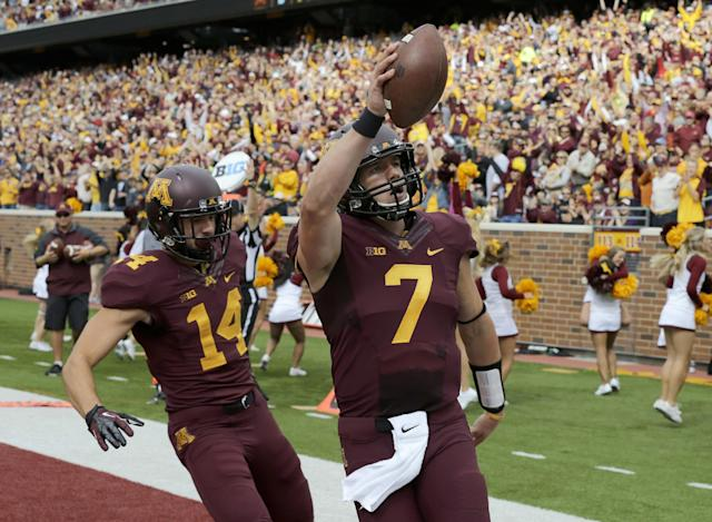 Minnesota quarterback Mitch Leidner (7) celebrates his touchdown with wide receiver Isaac Fruechte (14) during the first quarter of an NCAA college football game against San Jose State in Minneapolis on Saturday, Sept. 21, 2013. Minnesota won 43-24. (AP Photo/Ann Heisenfelt)