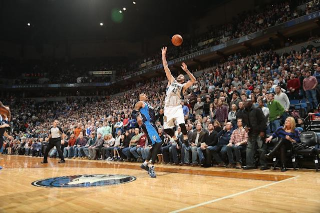 MINNEAPOLIS, MN - DECEMBER 30: Kevin Love #42 Minnesota Timberwolves Rick Adelman goes up for the ball against the Dallas Mavericks during the game on December 30, 2013 at Target Center in Minneapolis, Minnesota. (Photo by David Sherman/NBAE via Getty Images)
