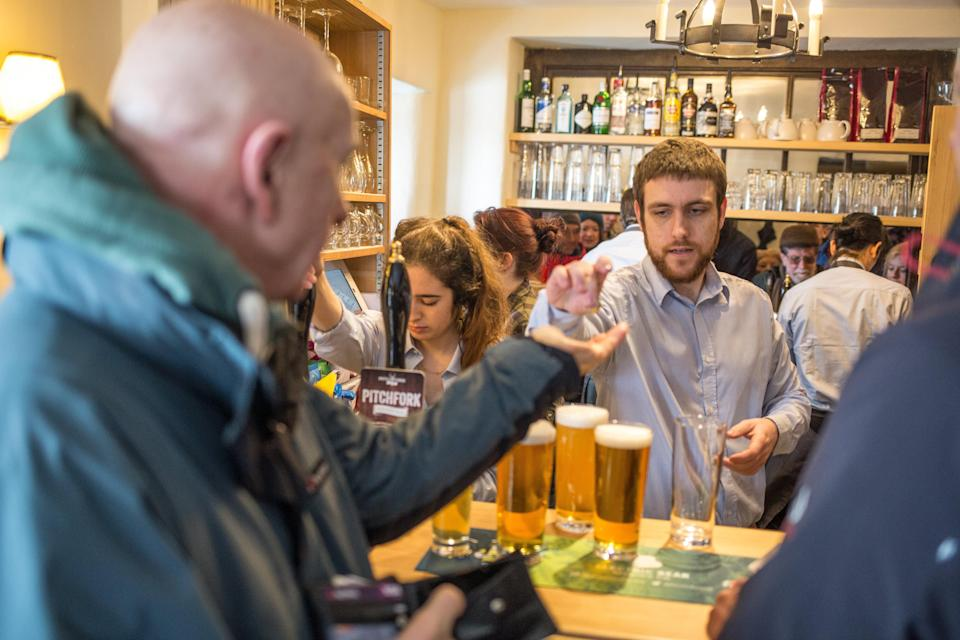Locals queue up to get a pint in the newly reopened Packhorse Inn (SWNS.com)