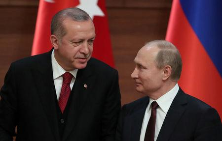 Presidents Tayyip Erdogan of Turkey and Vladimir Putin of Russia hold a joint news conference after their meeting in Ankara