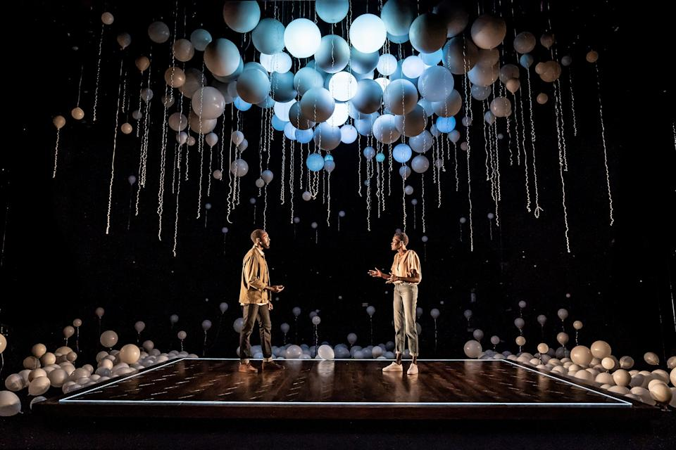 Tom Scutt's set design includes a canopy of balloons that light up at each scene change (Marc Brenner)