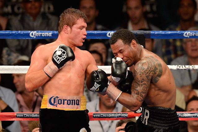 LAS VEGAS, NV - MAY 05: (L-R) Canelo Alvarez throws a left to the head of Shane Mosley during their WBC super welterweight title fight at the MGM Grand Garden Arena on May 5, 2012 in Las Vegas, Nevada. (Photo by Ethan Miller/Getty Images)