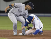 Toronto Blue Jays' Cavan Biggio is safe stealing second under the tag of New York Yankees' Gleyber Torres during the fifth inning of a baseball game in Toronto on Tuesday, June 4, 2019. (Fred Thornhill/The Canadian Press via AP)