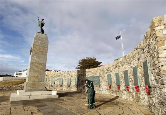 A worker cleans at the Liberation Monument dedicated to British soldiers who died during the 1982 South Atlantic War between Argentina and Britain in Stanley, Falkland Islands June 12, 2012.