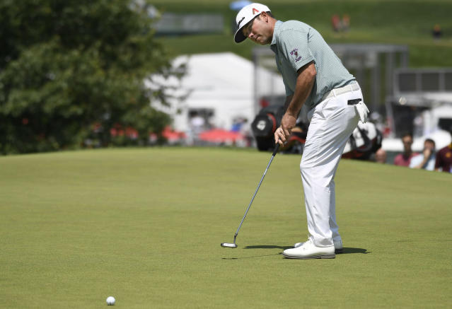 Chez Reavie putts on the 1st hole during the final round of the Travelers Championship golf tournament, Sunday, June 23, 2019, in Cromwell, Conn. (AP Photo/Jessica Hill)