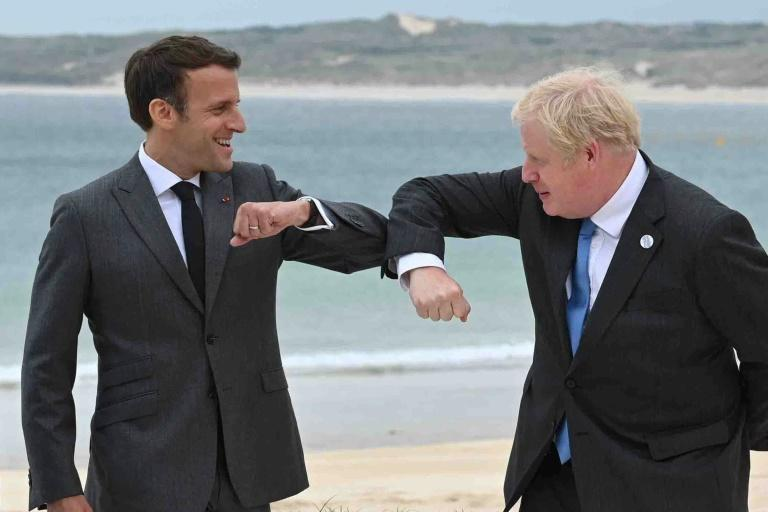 British PM Boris Johnson, right, said he hoped for cooperation with France after the submarine row (AFP/Leon Neal)