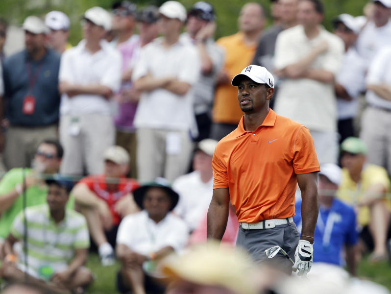 Tiger Woods watches his tee shot on the eighth hole during the first round of the Memorial golf tournament Thursday, May 30, 2013, in Dublin, Ohio. (AP Photo/Darron Cummings)