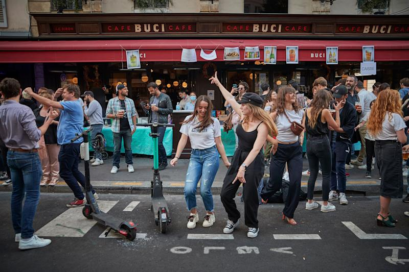 Parisians dance in the street in the 6th Arrondissement as Paris celebrates the first day of summer with Fete de La Musique with bands playing across the city on June 21. (Photo: Kiran Ridley via Getty Images)