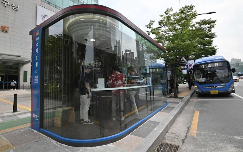The new booths are designed to provide a safe haven both from coronavirus and the brutal summer weather - JUNG YEON-JE /AFP