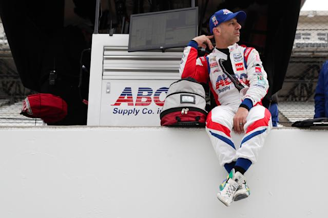 IndyCar driver Tony Kanaan, of Brazil, sits on the pit wall during auto racing testing at the Indianapolis Motor Speedway in Indianapolis, Wednesday, April 24, 2019. (AP Photo/Michael Conroy)