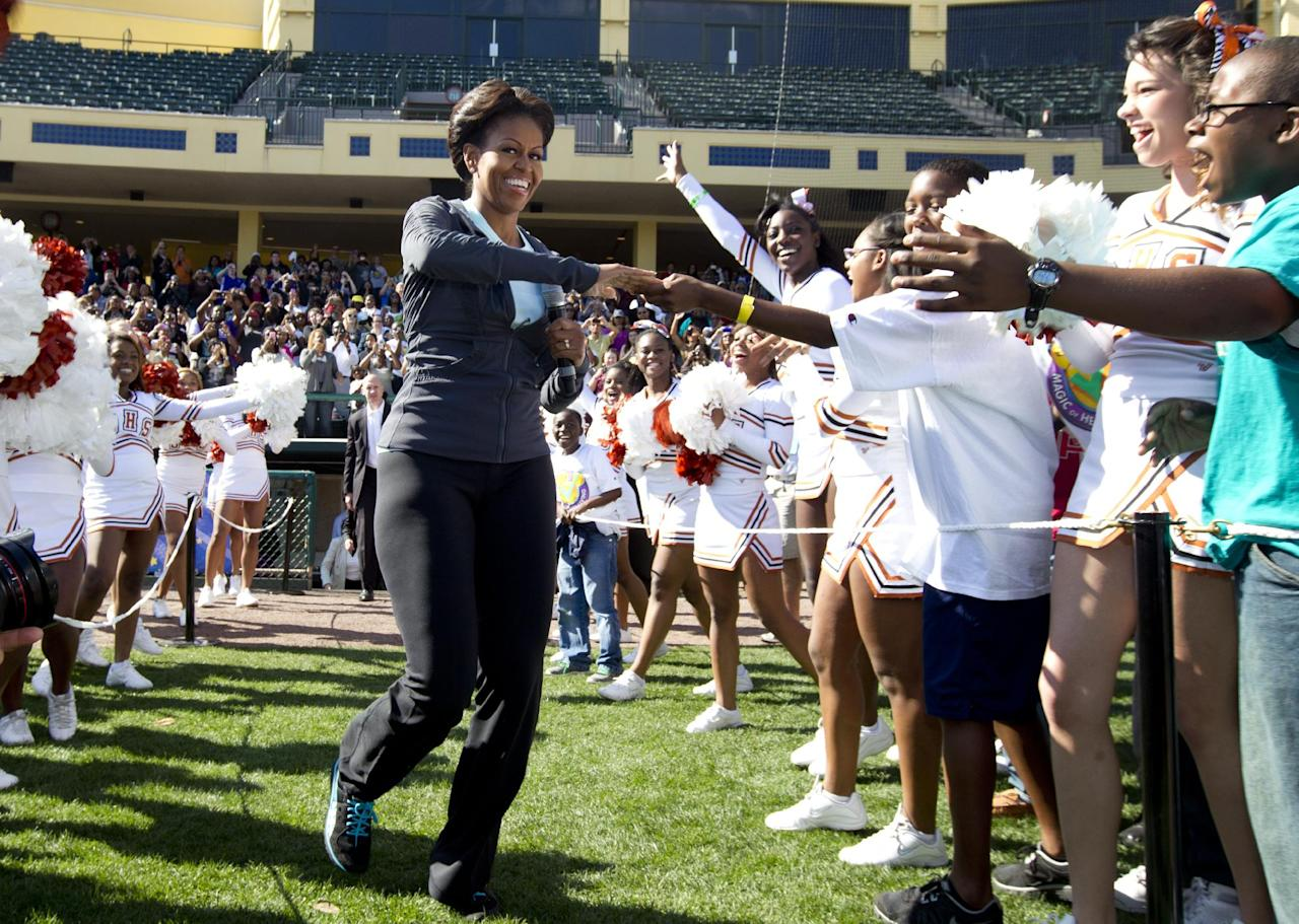 First lady Michelle Obama greets kids as she arrives for physical activity with kids at the ESPN Wide World of Sports Complex at the Walt Disney World Resort, Saturday, Feb. 11, 2012, in Orlando, Fla., during her three day national tour celebrating the second anniversary of Let's Move. (AP Photo/Carolyn Kaster)