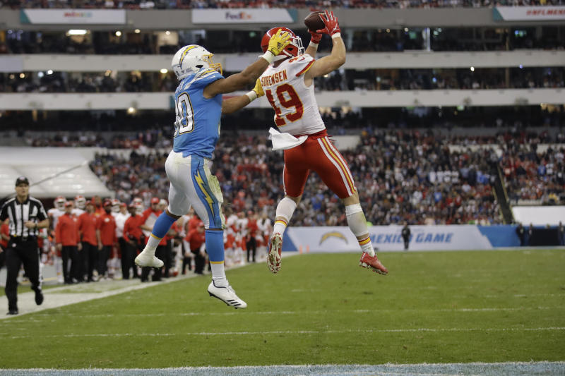 Kansas City Chiefs defensive back Daniel Sorensen, right, intercepts a pass intended for Los Angeles Chargers running back Austin Ekeler, left, during the second half of an NFL football game Monday, Nov. 18, 2019, in Mexico City. (AP Photo/Marcio Jose Sanchez)