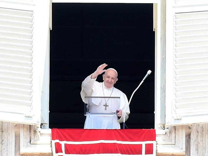 "Pope Francis delivers his blessing from the window overlooking St. Peter's Square at the Vatican on August 2, 2020 during the Sunday Angelus prayer. <p class=""copyright"">FILIPPO MONTEFORTE/AFP via Getty Images</p>"