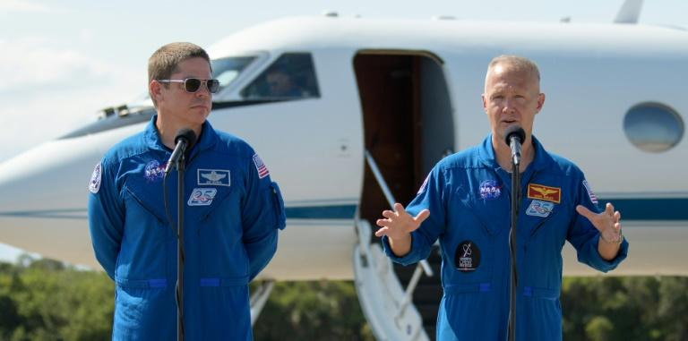 NASA astronauts Robert Behnken (L) and Douglas Hurley (AFP Photo/Bill INGALLS)