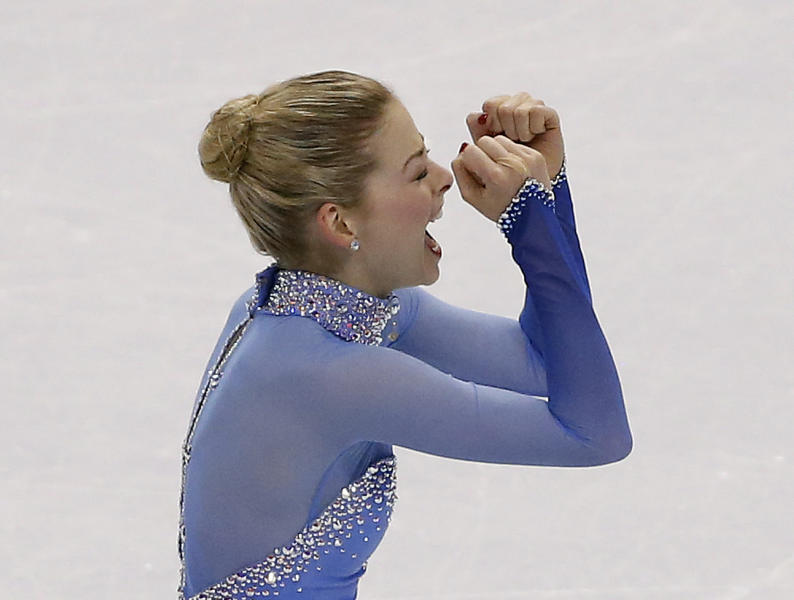 Gracie Gold reacts after skating during the women's free skate at the U.S. Figure Skating Championships in Boston, Saturday, Jan. 11, 2014. (AP Photo/Elise Amendola)