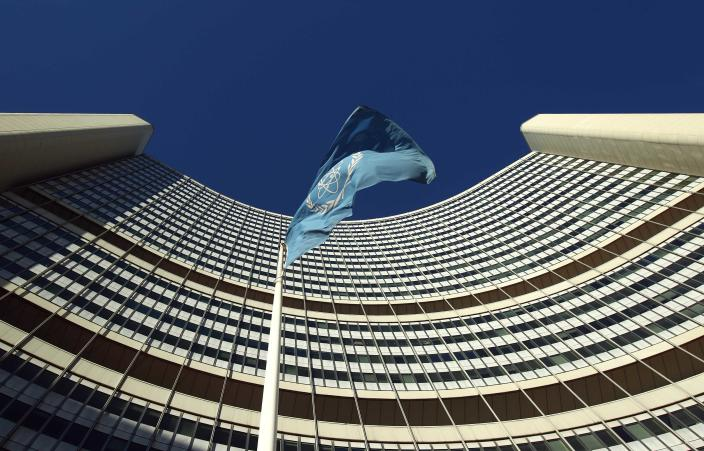 The flag of the International Atomic Energy Agency (IAEA) flies in front of its headquarters during a board of governors meeting in Vienna November 28, 2013. Iran has invited U.N. inspectors to visit a nuclear-related heavy water facility on December 8, their chief said on Thursday, a first concrete step under a plan to clarify concerns about Tehran's disputed nuclear programme. REUTERS/Heinz-Peter Bader (AUSTRIA - Tags: POLITICS ENERGY)