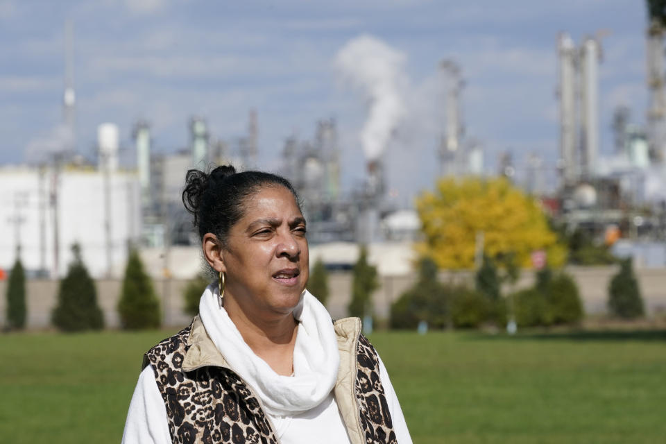 """Theresa Landrum is photographed near the Marathon refinery, Friday, Oct. 16, 2020, in Detroit. Landrum wasn't impressed when told that Environmental Protection Agency chief Andrew Wheeler had pledged $200,000 to promote """"community health initiatives"""" in her section of the city during his blitz of visits to battleground states in the presidential election campaign. (AP Photo/Carlos Osorio)"""