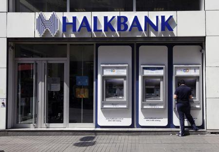 A customer uses an automated teller machine at a branch of Halkbank in Istanbul August 15, 2014. REUTERS/Osman Orsal