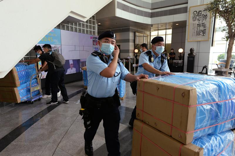 Under the new and controversial national security law, Hong Kong police arrested Jimmy Lai and raided the Apple Daily headquarters. According to media reports six others have also been arrested. Source: EPA