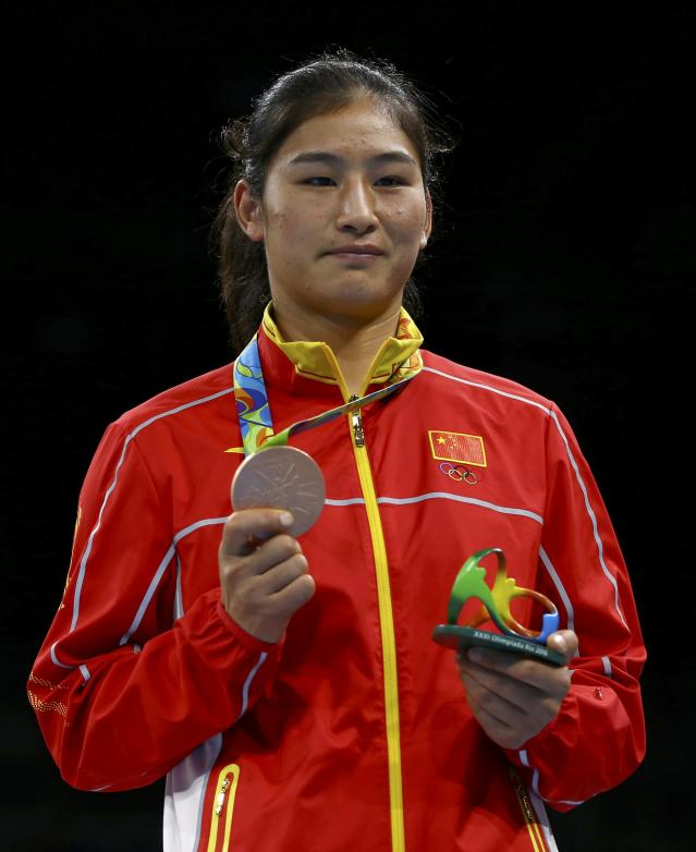 2016 Rio Olympics - Boxing - Victory Ceremony - Women's Middle (75kg) Victory Ceremony - Riocentro - Pavilion 6 - Rio de Janeiro, Brazil - 21/08/2016. Bronze medallist Li Qian (CHN) of China poses with her medal. REUTERS/Peter Cziborra FOR EDITORIAL USE ONLY. NOT FOR SALE FOR MARKETING OR ADVERTISING CAMPAIGNS.