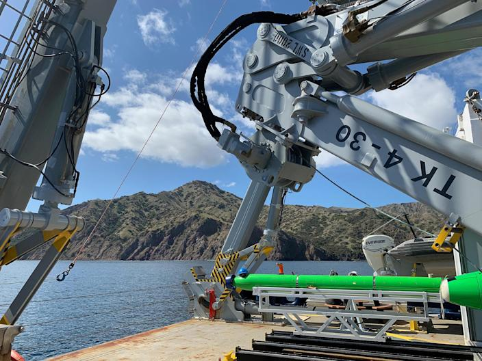 Scripps Researchers aboard the Research Vessel Sally Ride using the REMUS 600 and Bluefin automated underwater vehicles (AUVs) to survey the seafloor for discarded DDT barrels in March 2021. / Credit: Scripps
