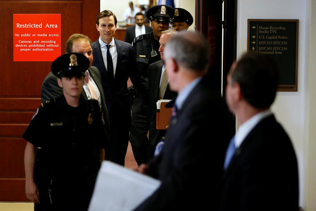 White House senior advisor Jared Kushner (C, background) departs after a closed-door meeting with the House Intelligence Committee on Capitol Hill in Washington, U.S. July 25, 2017.  REUTERS/Jonathan Ernst