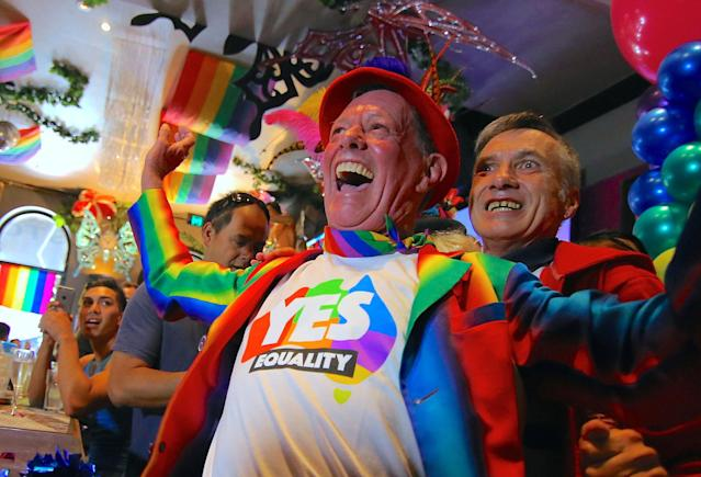 <p>Members of Sydney's gay community react as they celebrate after it was announced the majority of Australians support same-sex marriage in a national survey, paving the way for legislation to make the country the 26th nation to formalize the unions by the end of the year, at a pub located on Sydney's Oxford Street, Australia, Nov. 15, 2017. (Photo: Steven Saphore/Reuters) </p>
